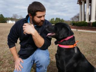 After being separated for two years, Chase Surles and his dog Max are back together just in time for the holidays. Max was given to Surles one month before he had brain surgery.