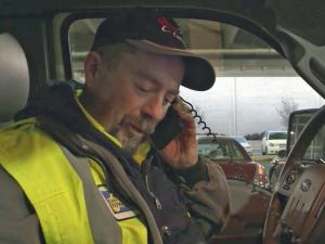 Thomas Stritzel takes a call for help from a motorist whose car won't start in freezing temperatures on Tuesday, Jan. 7, 2014.