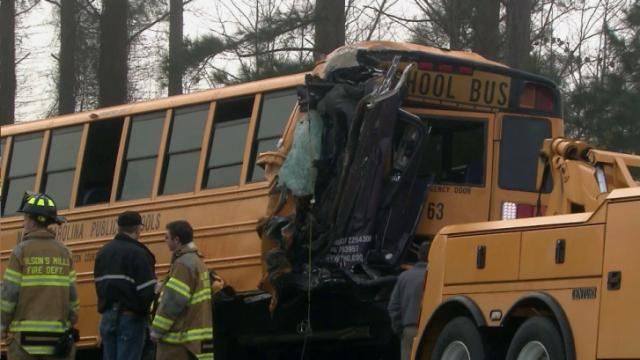 Thirteen people, including 11 students, were injured early on Jan. 15, 2014, when authorities say a tractor-trailer crashed into the bus as it was slowing down near Wilson Mills in Johnston County.
