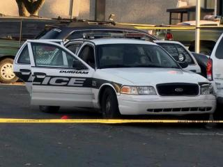 Police tape surrounds a Durham police cruiser on Nov. 19, 2013, after Jesus Huerta, 17, shot himself while handcuffed in the back seat.