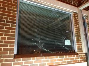 Several windos of the Durham Police Department's downtown substation were shattered by vandals on Jan. 19, 2014, the same night hundreds gathered to remember the Nov. 19, 2013, death of Jesus Huerta, who died after shooting himself while in police custody. (Beau Minnick/WRAL)
