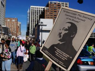A crowd gathers on Fayetteville Street in downtown Raleigh on Jan. 20, 2014, to honor the memory and legacy of the Rev. Martin Luther King Jr. (Richard Adkins/WRAL)