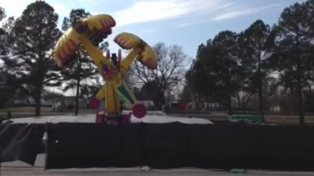 Three months after five people were thrown from The Vortex at the North Carolina State Fair, crews were disassembling the ride on Jan. 21, 2014, but not before running it again. An attorney for the ride's owner would not comment on why. (Amanda Lamb/WRAL)