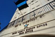 A flag symbolizing lost law enforcement officers flies above the Wayne County Sheriff's Office on Friday, Jan. 24, 2014, following the death of Sheriff Carey Winders.