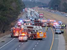 Westbound lanes of Interstate 40 between Gorman Street and Lake Wheeler Road in Raleigh were closed Jan. 26, 2014, after what police say was a fatal wreck. (Zac Gooch/WRAL)