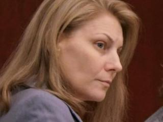 Amanda Hayes sits in a Wake County courtroom on Jan. 30, 2014, during her first-degree murder trial. (Chad Flowers/WRAL)