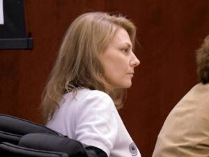 Amanda Hayes listens to testimony on Jan. 31, 2014, in her first-degree murder trial.