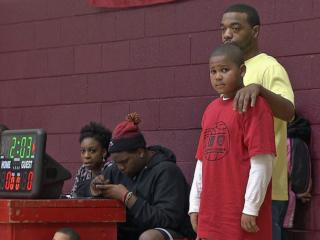 Trenten waits to take the court for the Durham Police Athletic League's basketball season opener on February 1, 2014.