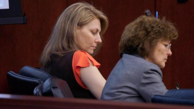 Amanda Hayes, left, and one of her attorneys, Rosemary Godwin, listen to testimony during Hayes' first-degree murder trial on Feb. 6, 2014. (Chad Flowers/WRAL)