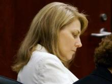 Amanda Hayes, left, listens Monday, Feb. 10, 2014, to a witness on the 10th day of testimony in her first-degree murder trial for the July 13, 2011, death of Laura Ackerson. (Chad Flower/WRAL)