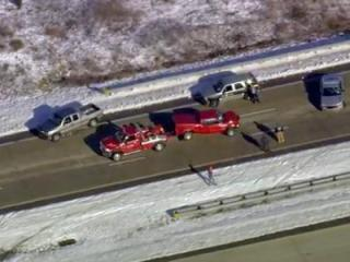 Officials respond to a wreck on U.S. Highway 64 on Friday, Feb. 14, 2014.