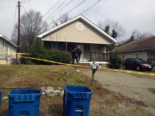 Durham police investigate after a 5-month-old girl was wounded in a shooting at 402 Macon St. on Feb. 19, 2014.