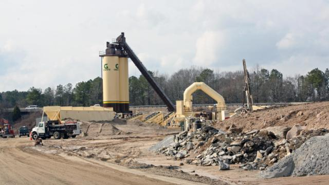 Construction crews put the finishing touches on the Fortify asphalt plant on Wednesday, Feb. 19, 2014.