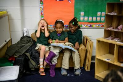 From left, Amelia Cinson, Jayah Mathis and Chosyn Colbert, students in the all-day prekindergarten program at Charles R. Drew Charter School in Atlanta, read the book 'No David.' The school's success is key to the East Lake neighborhood's revitalization.