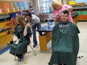 Students get their heads shaved at Sanderson High School on Monday Feb. 24, 2014 to raise money for children's cancer research.