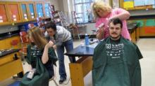 IMAGES: Raleigh high school students go bald for a cause