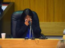 Helen Reyes cries after taking the stand Thursday, March 13, 2014, in the trial against her former boyfriend, who is accused of torturing and killing her daughter in 2010.