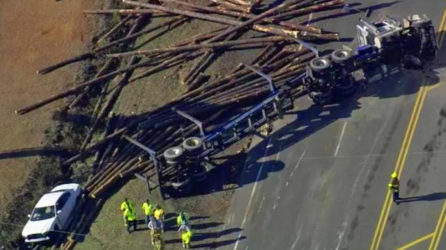 Log truck overturned in Sanford on March 20, 2014