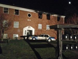 Fire damaged an apartment building on Peyton Street in Raleigh on March 23, 2014. Authorities said eight people jumped from upper floors to escape the flames.
