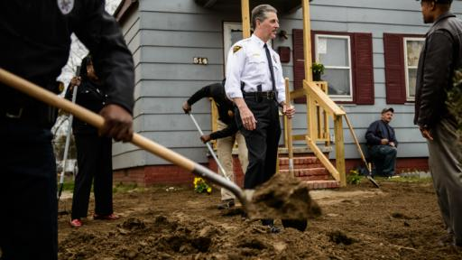 Fayetteville Police Chief Harold Medlock, fellow officers and city officials work on a yard on Moore Street, near downtown, in an effort the chief calls 'gold' to build community trust. Photo by James Robinson of The Fayetteville Observer.