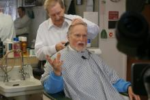 Red Springs resident James Melvin gets a trim while he talks about the 1984 tornado that hit the town.