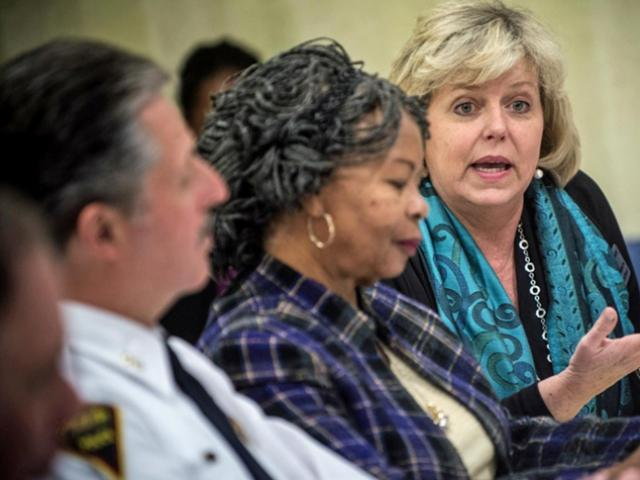 Fayetteville Police Chief Harold Medlock, Jeannette Council chairwoman of the Cumberland County Board of Commissioners listen as Mary Holmes, Executive Director of the Cumberland Community Foundation, Inc.(right) speaks to other community leaders that attended a forum, organized by The Fayetteville Observer, to talk about what the paper's reporting on crime in other towns has shown and discuss ideas for bringing the community together for solutions. The meeting was held at the Fayetteville Observer on Thursday March 27, 2014.