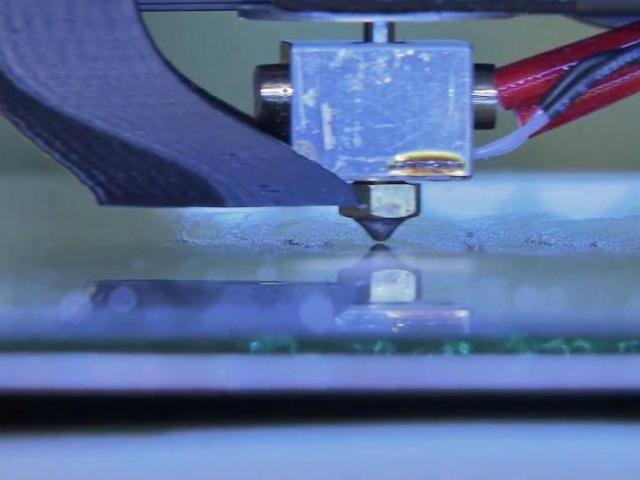 3D printers spit layers of heated, molded plastic into shape based on a pattern programmed in code.