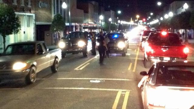Cars cruise Benson on Saturday night, April 12, 2014.