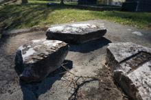 Crumbling head stones in City Cemetery are remnants of an April 2011 tornado that hit downtown.