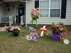 A memorial to Danielle Locklear outside her Hope Mills home features bright colors, images of butterflies and bottles of bubble mix to help her family and friends recall the way the slain teen lived.