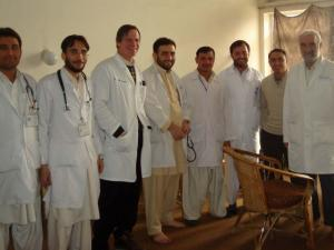 Dr. Randall Williams, third from left, stands with doctors at Cure International Hospital.