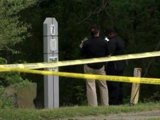 Durham police investigate on the morning of May 7, 2104, the discovery of a female body near the entrance of Rocky Creek Trail in the southern part of the city.