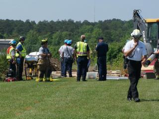 Authorities work to free a man trapped in a trench in Fayetteville.