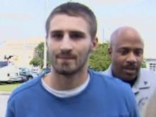 Nicholas Holbert, in this 2012 photo, is escorted to the Fayetteville Police Department after being arrested on a charge of failing to register as a sex offender.