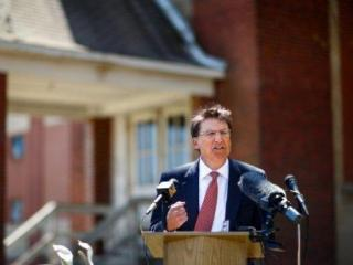 North Carolina Gov. Pat McCrory gives a speech announcing economic development programs designed to rehabilitate buildings all across North Carolina, Wednesday, April 13, 2014, in High Point, N.C., in front of the Pickett Cotton Mill that is soon to be the new home of BuzziSpace, a Belgium company known for its high-quality, green office furniture. (AP Photo/News & Record, Jerry Wolford)