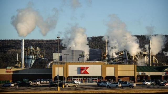 Steam rises from a door-making factory behind a Kmart near Towanda, Pa. Gas companies have drilled 2,000 wells in Bradford County since 2008, boosting the rural community's tax base by $100 million. Though drilling has slowed recently, the gas fields are spinning off new industry, such as a $750 million electricity-generating plant.