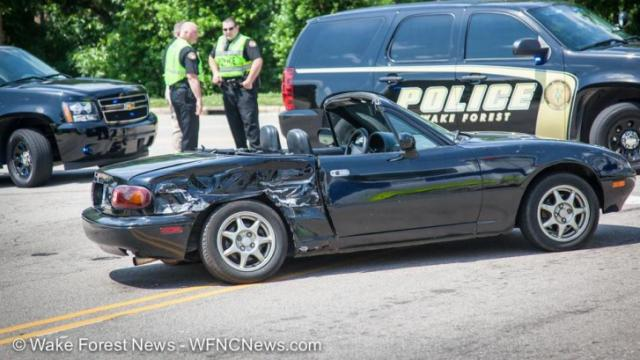 One student was hospitalized after a car collided with a school bus from Wake Forest High School Wednesday afternoon. (Courtesy of Wake Forest News)
