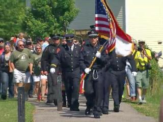 Firefighters and police escorted a piece of the World Trade Center to a place of honor in Holly Springs. It will be part of a War on Terror memorial.