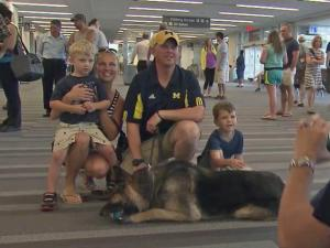 Fort Bragg Army Staff Sgt. Andy Wolf reunites with his canine partner, Iras, at Raleigh-Durham International Airport on Thursday, June 19, 2014.
