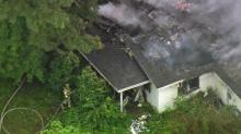 IMAGES: Crews battle fire at abandoned Raleigh house