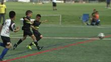 IMAGE: Aspiring soccer stars take to the field in Friendship Cup