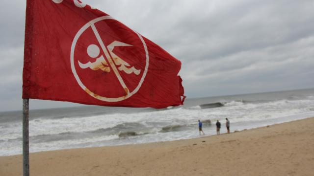 A caution flag flies at Kill Devil Hills following Hurricane Arthur.