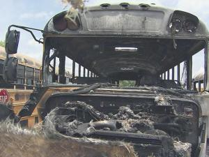 Four Wake County Public School System buses were damaged in a fire Saturday night at Southeast Raleigh High School, and authorities believe the fire may have been set intentionally.