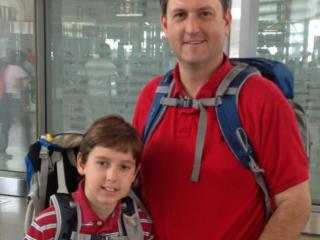Charlie Ramquist, 11, and his father Neil, left Raleigh-Durham International Airport Sunday for trip they hope will change their own lives and the lives of others who, like Charlie have eosinophilic esophagitis. (Photo courtesy: Susan Ramquist)