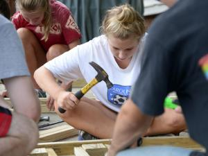A group of 36 teens spread across Wake County Friday to repair nearly a dozen homes as part of the Highland Service Project.