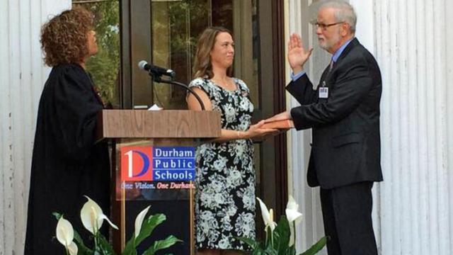 Bert L'Homme is sworn in July 14, 2014, as the superintendent of Durham Public Schools