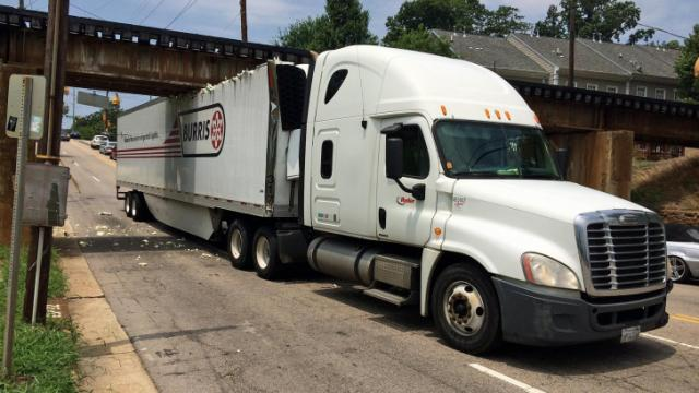 A tractor-trailer driver jammed the rig under the Peace Street railroad bridge on Tuesday afternoon.