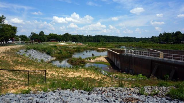 A sinkhole beneath a 2-year-old dam drained Hope Mills Lake in June 2010.