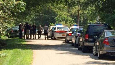 Wake County sheriff's deputies were on the scene where two people were found dead at a home on Howard Road in Fuquay-Varina on July 19, 2014.