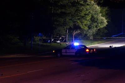 A driver died and a passenger was hurt when their car left the road and crashed into trees off North New Hope Road in Raleigh on July 21, 2014.